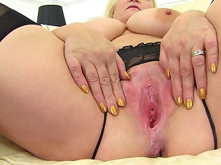 Blonde mature BBW Lacey Starr spreads her pussy lips in stockings