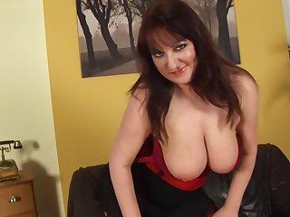 bbw mature Kassandra feeds her shaved pussy with pine yellow dildo