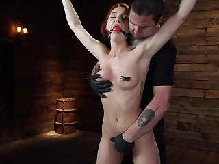 Smiling redhead model Lacey Lennon gets on a high with bondage