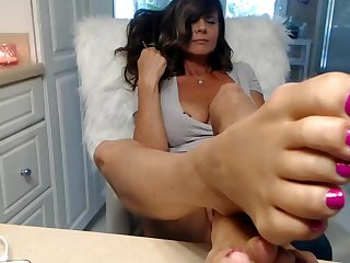 mature lady shows pretty fingertips and slit