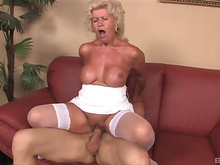 Mature granny Effie gives a titjob with an increment of rides her younger lover