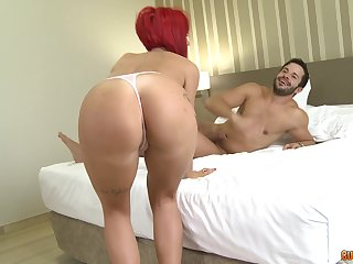 Redhead mature drops on her knees to have a go sex with two dudes